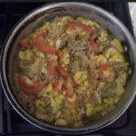 Ackee and Saltfish cooking on stove